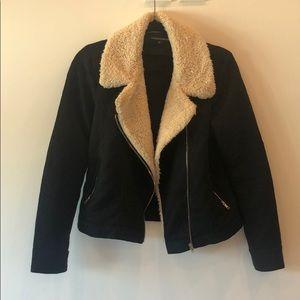 Black jacket with cream fur